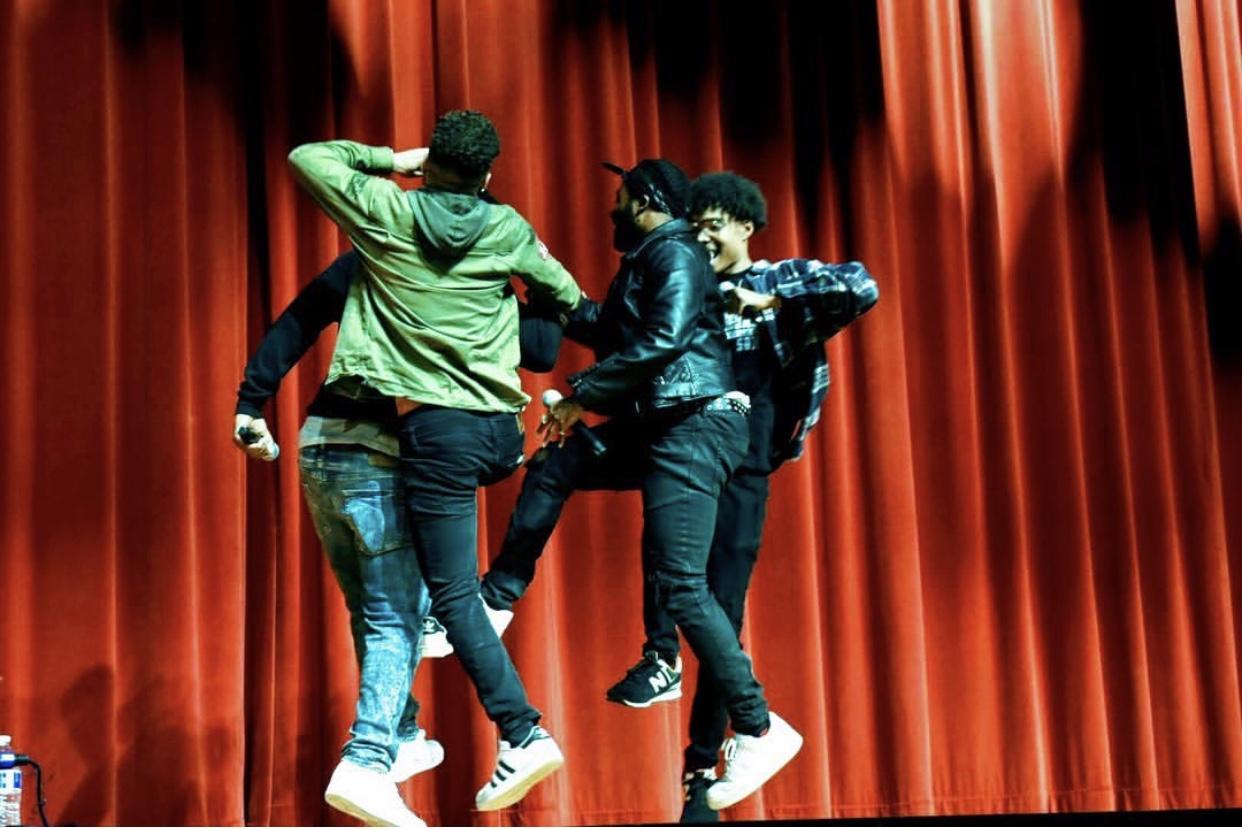 Co exist performing on stage at Living the Example concert