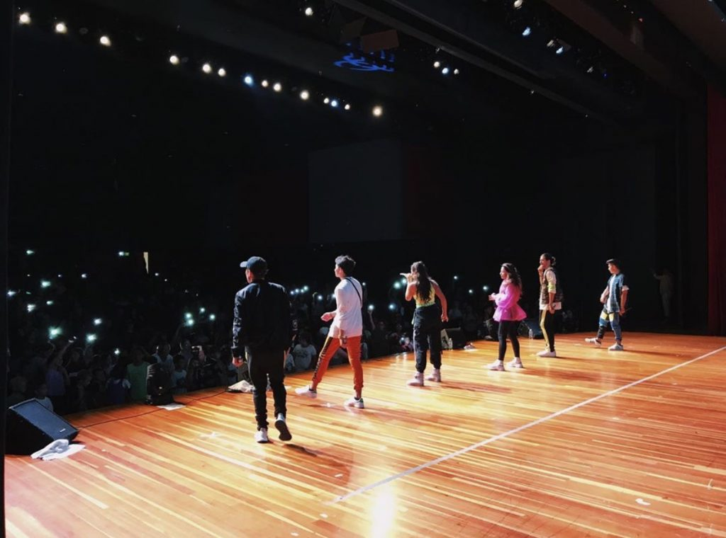 JAGMAC performing on stage at Living the Example contest at North County High School